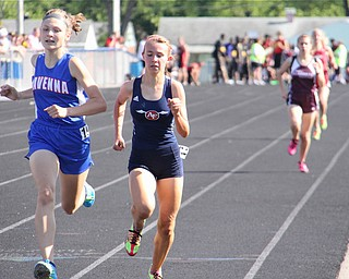 Olivia Chinn (left) of Ravenna runs neck and neck with Carissa Jenkins (right) of Austintown Fitch to the finish line of the 1600 meter run during Fridays Division one district championship track meet at Austintown Fitch High School.  Dustin Livesay  |  The Vindicator