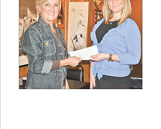 Lori Everly, left, president of the Columbiana Area Business and Professional Women's Group, recently presented a check in the amount of $200 to Casey Bertolette, development associate for Beatitude House in Youngstown. CAPBW also supports Christina House in Columbiana and Buckeye Girls State programs. It also is donating three $1,500 scholarships to area high school seniors. For information about the group contact Everly at leverly1101@aol.com.