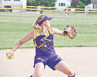 Champion third baseman Haley McAllister throws the ball to first base to get an out during Tuesday's matchup against Poland at North Elementary School in Poland.