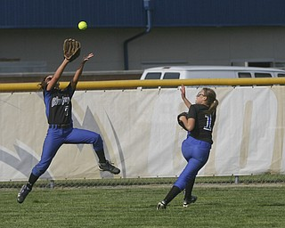 JESSICA M. KANALAS  | THE VINDICATOR..Jackson Milton's #7 Shannon Ricketson jumps to catch an outfield fly but drops it due to her teammates close pressence during the top of the first inning against Mathews for the Division 3 Regional Semifinal game at Kent State University.