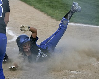 JESSICA M. KANALAS  | THE VINDICATOR..Jackson Milton's #7 Shannon Ricketson slides safely into home during the bottom of the third inning against Mathews for the Division 3 Regional Semifinal game at Kent State University.