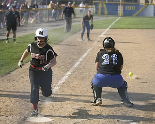 JESSICA M. KANALAS  | THE VINDICATOR..Due to an error on a pick-off attempt at third base, Mathews #16 Hollie Shreves safely steals home during the top of the fourth inning against Jackson Milton for the Division 3 Regional Semifinal game at Kent State University.