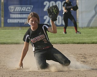 JESSICA M. KANALAS  | THE VINDICATOR..Mathews #3 slides on her knees as she makes an catch during the bottom of the fourth inning against Jackson Milton for the Division 3 Regional Semifinal game at Kent State University.