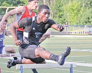 East's Valentino Sewell clears the first hurdle during the boys 300-meter event at Wednesday's Division I regional track meet at Austintown Fitch High School. Sewell advances to Saturday's finals in the 300 and 110 hurdle events.