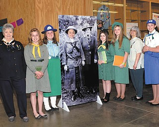 More than 1,500 Girl Scouts and their families attended the Camporee in April at the  Canfield Fairgrounds. The event was part of a yearlong celebration of Girl Scouts' 100th anniversary. From left to right are participants Trudee Davis, Briana Rich, Samantha Dilts, Karina Betts, Monica Doyle, Megan Doyle, Barb Bott and Elysabethe O'Hara. The local Girl Scouts of North East Ohio has 40,000 girls and 14,000 adult members in 18 counties.