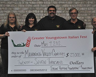 The Greater Youngstown Italian Fest Committee, along with the Italian Heritage Foundation of Youngstown Inc., has distributed more than $27,000 to local charities and scholarships to Youngstown State University students from the 2011 Italian Fest. The charities are Second Harvest Food Bank, The Rescue Mission, Beatitude House, Rich Center for Autism, St. Vincent de Paul Society and Akron Children's Hospital Boardman, among others. Committee member are, from left to right, Linda Ilich, Anna D'Amato, John Rossetti, Anthony Julian and Joe Lenefante