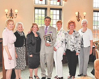 Youngstown Area Federation of Women's Clubs Inc. honored WYTV 33 News anchor Stan Boney at its annual awards and scholarship presentation May 16 at the Youngstown Country Club. From left are members Marilyn Morelli, Lucile Bartlemay, Barbara Higgins, Boney, Rusti Puromaki, Catherine Campana and Sally Schlabaugh.