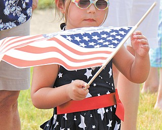 4-year-old Olivia Brugnoni of Boardman waves a flag while watching the Memorial Day parade in Boardman.