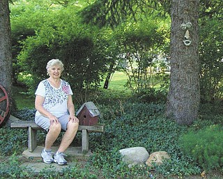 Helen Gormley of Columbiana can't help but smile in her backyard garden, a peaceful place brimming with whimsical touches. Her garden will be showcased as part of the third annual Alice in Wonderland Tea and Garden Tour planned by Columbiana Women's Club from 11 a.m. to 2 p.m. June 8 and 9. Tea will be served at the clubhouse, 121 N. Main St., Columbiana, with an accompanying Alice in Wonderland Alexander Doll Raffle. The garden tour includes the Lutheran Church Garden, Barleytwist Tea Garden, Maria Green's rustic garden, John Hippley's Park Garden, Donna Bekar's backyard garden with koi pond and waterfall, and Gormley's garden. Tickets may be purchased in advance at Vivian's and the Next-to-New Shop. On the days of the event, tickets may be bought at the Women's Club and each of the participating gardens. Tickets for the tea cost $10, for the garden tour, $10, and for both events, $15.