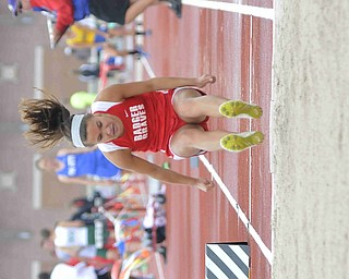 Jennilyn Krumpe of Badger makes a jump during the girls long jump Friday afternoon at the State Track Meet in Columbus. She would finish eleventh in divison three.