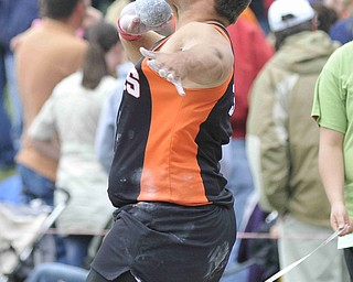 Jacob Chiclowe of Mineral Ridge throws the shot put Friday afternoon at the State Track Meet in Columbus.