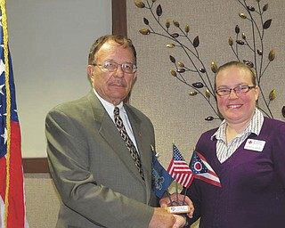Jessica Jaros, right, Mahoning Valley Red Cross director of emergency services and armed services, was the guest speaker at a recent meeting of the Mahoning and Shenango Valleys Chapter of the Military Officers Association of America. Col. Walter Duzzny, USA, Ret., president of the association, presents her with the chapter's unique flag set, representing the United States, Pennsylvania and Ohio. The group normally meets for dinner on the fourth Thursday of each month. For reservations and information call Don Oglesby at 330-568-4456. For membership information call Don Rasile at 330-758-3348.