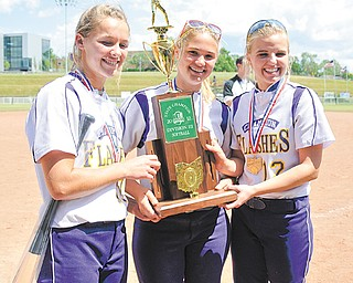 Champion players, from left, Lindsay Swipas, Haley McAllister and Alison Sorber pose with the Division III state championship trophy following the Golden Flashes' 2-0 win over Bloom-Carroll on Saturday in Akron.