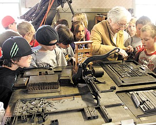 Students from Canfield's Hilltop Elementary School tour the Mahoning Dispatch print shop as part of their look at historic Canfield landmarks. Eileen Merz from the Canfield Historical Society showed the youngsters how type was set to produce the now-defunct city newspaper during the Tuesday tour.