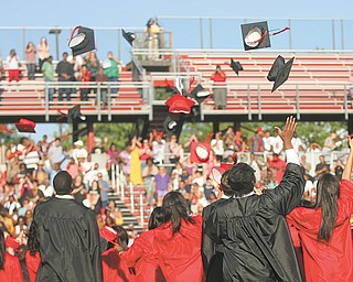 Campbell High School graduates of the class of 2012 throw their caps into the air in celebration at the end of their commencement ceremony.