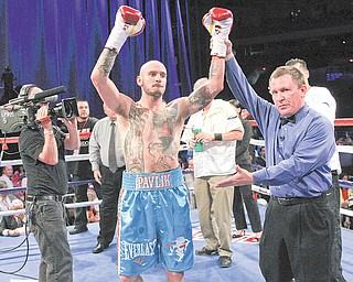 Top Rank, March 31, 2012. While Kelly Pavlik has performed well in other cities — he improved to 1-0 in San Antonio after his knockout of Aaron Jaco in March, above — no city has done more for his career than Las Vegas, where he is 11-0 all-time. He'll try to make it 12-0 when he faces Scott Sigmon tonight.