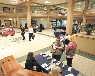 The lobby of 20 Federal Place in downtown Youngstown was the scene for a college fair to attract students and inform them about education opportunities. Dawn Douglas and Shaclecha Stoddard visited the ETI Technical College table on Thursday staff ed by Charlotte Stahl, far left, and Kathy Christi.