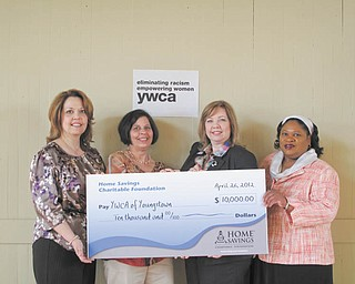 The Home Savings Charitable Foundation recently donated $10,000 to the YWCA of Youngstown. The funds will be used to support YWCA Women Artists: A Celebration!, observing its 30th anniversary in the Valley. All proceeds from the art show benefit the YWCA Barbara Wick Transitional Housing program for women. The show will take place at the John J. McDonough Museum of Art at Youngstown State University. The gala preview party is scheduled for June 16, and the show will be available from 11 a.m. to 4 p.m. Tuesday through Saturday from June 19 to July 27. The exhibit is free. From left are Trish Mohan, assistant vice president at Home Savings; Cheryl Eddie Deibel, co-chairwoman of the art show; Leah Brooks, interim executive director, YWCA; and Anna Barksdale, YWCA director of housing with supportive services.