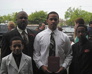 Ronald Casey Jr. stands with his sons Ronald Casey III, Donavan Casey and Jalen Casey. All are from Youngstown.