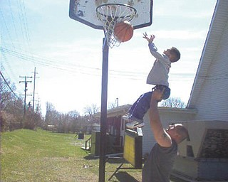 That'll be a great shot! Julian Cordova gives his son Nate a little boost. They are from Canfield. Photo submitted by Evelyn Cordova.