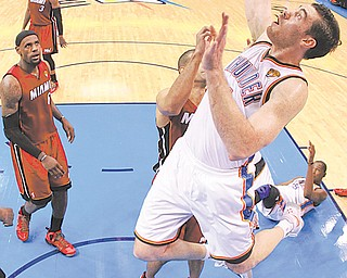 Oklahoma City Thunder power forward Nick Collison (4) shoots against the Miami Heat during Game 1 of the NBA finals Tuesday in Oklahoma City.