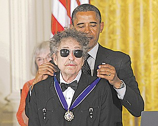 President Barack Obama presents rock legend Bob Dylan with a Medal of Freedom on May 29 at the White House.