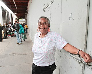 Annie Hall stands outside on the loading platform of the Gleaners Food Bank on Pyatt Street. Gleaners distributes food to the community every Tuesday from the South Side location. Hall has been volunteering there for years.
