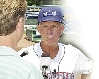 Mahoning Valley Scrappers manager Ted Kubiak #26 takes questions from members of the local media at Eastwood Field on Saturday afternoon.