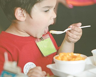 Dominic Hurd, 2, has macaroni and cheese at Woodside Elementary School in the Austintown School District on