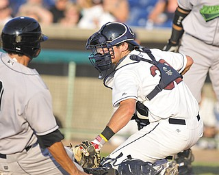 Mahoning Valley Scrappers catcher Jeremy Lucas (32) waits for Jamestown Jammers baserunner Anthony Gomez at the plate during Thursday's New York-Penn League baseball game at Eastwood Field in Niles. Gomez was out, but the Jammers got the 6-2 win.