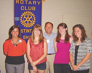 The Rotary Club of Austintown has awarded scholarships to Amanda Rouan, second from left, Kayleigh Choma, second from right, and Christine Grego, right. Also pictured are Deanna Spirko, far left, Austintown Rotary president, and Gary Reel, center, Interact adviser. The recipients met at a recent luncheon. Usually only two scholarships are awarded, but this year the applicants were so impressive in their achievements the club made an exception and awarded all three.