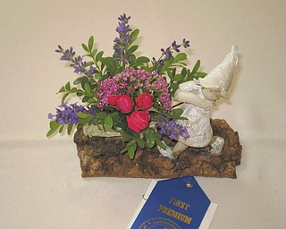 At the Garden Forum Flower show, which took place recently at Fellows Riverside Gardens, Dolly Vivalo won a National Garden Club honor for this Petite Award Design. The show was presented by the Garden Forum of Greater Youngstown.