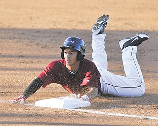 Scrappers baserunner Jairo Kelly slides safely into third base to complete a triple in the bottom of the third inning of Monday's game at Eastwood Field.