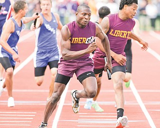 Liberty's Marquis Williamson takes the baton from teammate Frank Bond for the final leg of the 4x400-meter relay at the state track and field meet on June 2 at Jesse Owens Stadium in Columbus. Williamson is headed