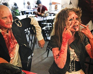 MADELYN P. HASTINGS..At the 'Zombie Prom' in Poland, Ohio, Austin Bayer, 17, and Breanna Keever, 17, of Boardman, Ohio show off their extreme zombie makeup. They both put in a great amount of time and effort for the Zombie Prom on June 28, 2012.