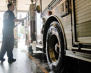 Firefighter Scot Murray of Boardman washes a firetruck at the Boardman Fire Department. The firefighters are taking extra care to prepare for the busy holiday weekend. Firefighters say the region's dry conditions and use of fireworks can bring disastrous results.