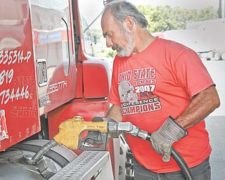 Paul Speero of Boardman fills up his truck with diesel fuel priced at $3.49 at the Travel Center of America at Interstate 80 and state Route 46 in Austintown.