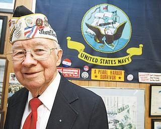 Pearl Harbor survivor Robert Bishop attends a Pearl Harbor observance at Amvets Post 44 in Struthers.