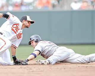 Cleveland Indians' Lou Marson, right, safely steals second during the fourth inning of Sunday's game as Baltimore Orioles second baseman Brian Roberts applies a late tag in Baltimore. The Indians won 6-2.