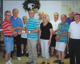 """In keeping with one of its mottos, """"to educate the orphan,"""" Canfield Odd Fellows Lodge presented its 2012 scholarship to William """"Bill"""" Magnuson, second from the left, front, whose father, the late Bob Magnuson, was an outstanding Canfield patrolman. Bill, who is actively involved in community service organizations, plans to attend Youngstown State University to study law enforcement, hoping to follow his father's footsteps and work for the city of Canfield. The lodge, which received its Canfield charter in 1850, has presented a scholarship to a deserving graduate for the last seven years. Presenting the scholarship is John Weaver, lodge vice grand, and also in the front row are Sandy Magnuson, Bill's mother, and lodge members George Makar and Lloyd Schooley. Standing in back, from left, are Richard Eberth, Ellen McCreary, Howard Young, Al Thonpson and Everett McCreary. Not pictured is lodge member Sparky Ashby."""