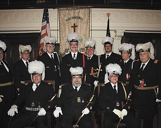 St. Johns Commandery 20, Knights Templar of Youngstown, conducted its annual installation of officers recently at the Masonic Temple in Youngstown. Taking office were Robert K. Ellway, eminent commander; Dominic M. Lucarelli, generalissimo; James A. Streeky, captain general; Timothy N. Flack, senior warden; D. Joseph Moore, junior warden; Richard J. Brady, recorder; Timothy A. Johnson, treasurer; Zel E. Bush, prelate; Gary S. Farrant, standard bearer; James B. Parker IV, sword bearer; and William M. Weems, trustee. Sitting, from left to right, are Lucarelli, Ellway and Streeky, and standing are Dale E. Hawkins, Farrant, Parker, Brady, Moore, Bush, Flack and Johnson.