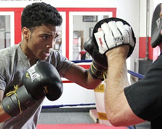 William d Lewis The Vindicator  Boxer Popo Salinas works out with trainer Jack Loew at Southside Boxing Club 7-3-12.
