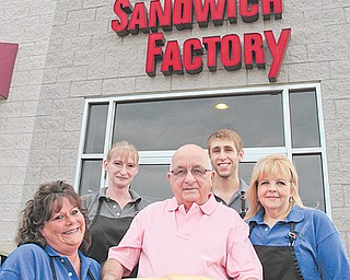 From left, longtime workers Sonya Shar and Monique Stilson, along with sandwich Factory owner Joe Loree and