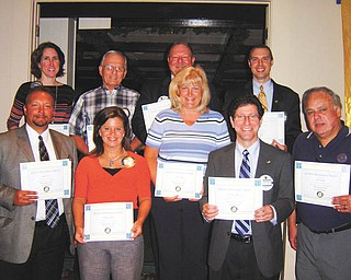 Several Austintown Rotary Club members have received certificates for perfect attendance for the fourth quarter of the year. In the front row, from left to right, are Mark Cole, Deanna Spirko, Tracie Kaglic, Dr. Mitch Dalvin and Jerry Haber. Back row: Jennifer Connelly, Tony Cebriak, Chuck Baker and Brian Laraway. Not pictured are Brian Frederick, Gary Reel, Mal Culp and Kristofer Sperry.