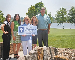 The course at the Lake Club in Poland will be the site of a golf outing Au.g 1 to benefit Akron Children's Hospital Mahoning Valley. From left are Amanda Watanakunakorn, Raquel Pacheco, JoAnn Stock, Chris Muransky and Ed Muransky. Photo by MADELYN P. HASTINGS | THE VINDICATOR