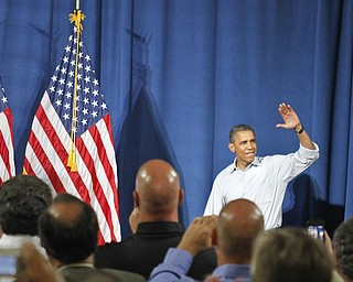 MADELYN P. HASTINGS | THE VINDICATOR..President Barack Obama waves to his crowd as he walks into the room in Dobbins Elementary School in Poland, Ohio on July 6, 2012. ... - -30-..
