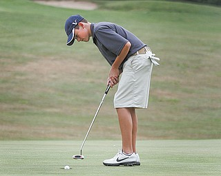 Cory Stefanec, 17, of Cardinal Mooney High School, sinks a putt on the 18th hole at Diamond Back Golf Course in Canfield, during the boys' qualifier Thursday for The Greatest Junior Golfer of the Valley golf tournament. Four more golfers advanced to the finals, which will be July 21 at Trumbull Country Club.