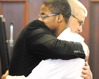 Shonqualin Hendrix, 16, hugs his attorney Mark Lavelle immediately after a jury of seven men and five women cleared him of murder charges in Mahoning County Common Pleas Court.