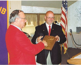 Canfield Lions Club had its 34th installation of officers in June. At left is newly installed President Dan Grossman presenting Harry Pancher, past president, the King Lion Plaque. PDG Lion Ted Filmer conducted the installation of the following 2012-2013 officers: Grossman, president; Carmela Abraham, second vice president; Phil Bova, treasurer; Rich Yager, tail twister; Marilyn Schmidt, lion tamer; Pete Cannell, membership and public relations; and Pancher, immediate past president.