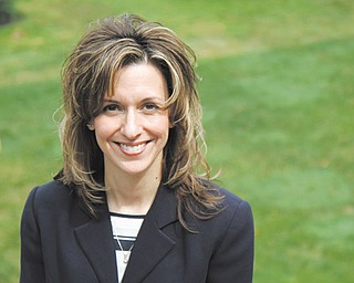 Lynn Robinson, at home in Niles, was hired recently as the executive director of the Children's Center of Mercer County in Hermitage, Pa., after nearly three years without work.